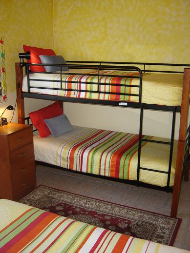 Bunkbeds share the second bedroom with a double bed